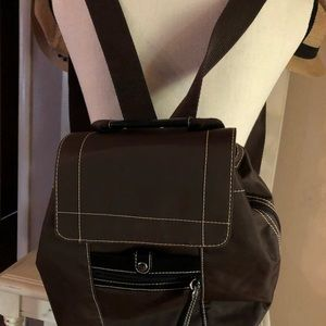A nice brown backpack purse
